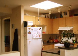 Top of the stairs is the kitchen and the skylight opens!